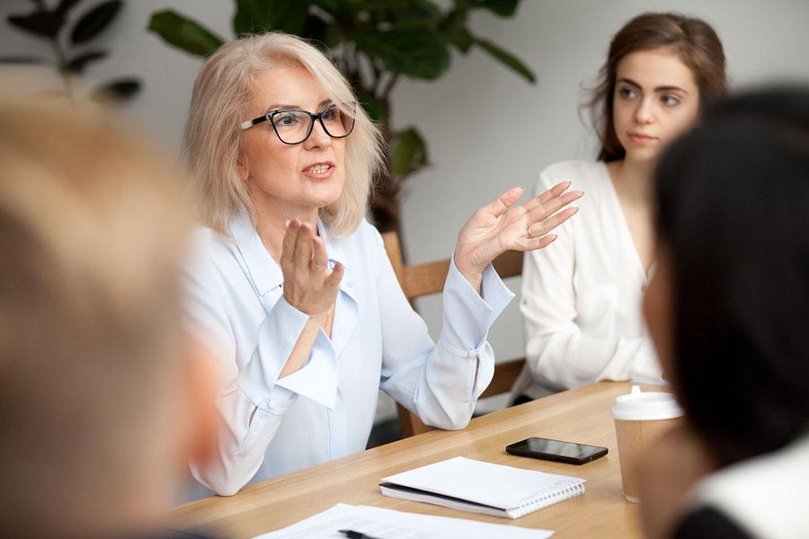 Attractive Aged Businesswoman, Teacher Or Mentor Coach Speaking